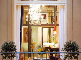 Apart Hotel Buenos Aires Balcony Chair Chandelier Window Plants Table
