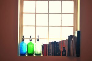 Old Water Siphons Books Against Brick Glass