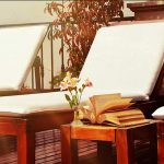 Three Lounge Chairs White Cushions Book Flower