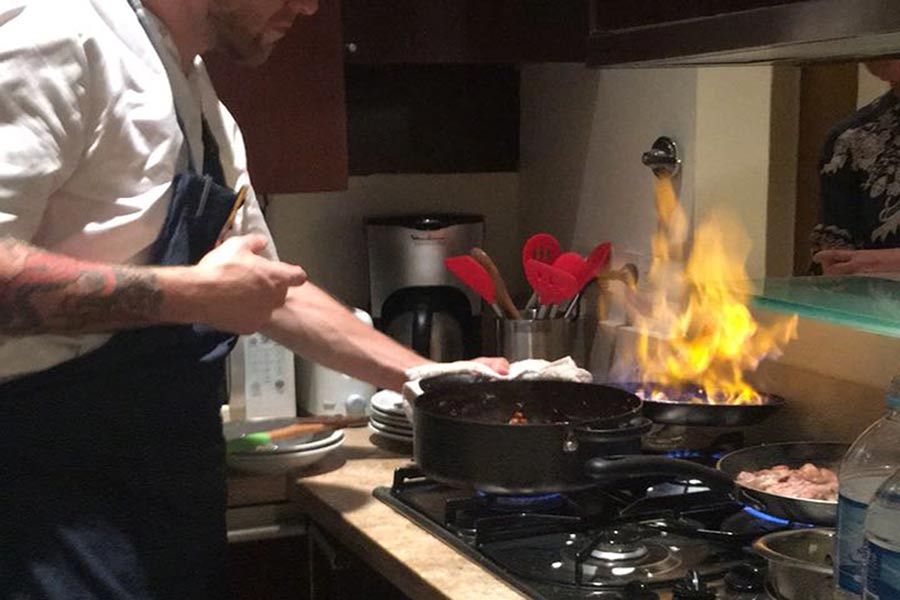 Poetry Building private chef apartments Recoleta private cooking class fire on pan